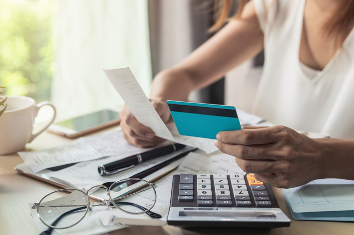 Woman checking bills, by iStock